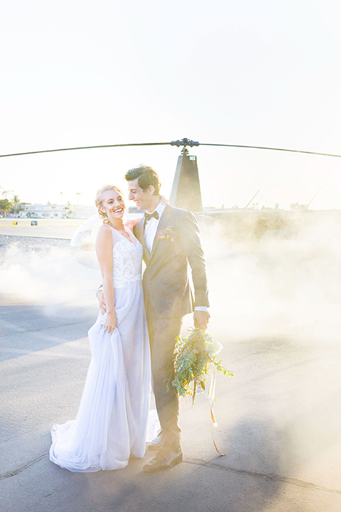 hangar-21-vertical-shot-of-bride-and-groom-by-helicopter