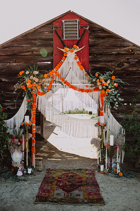 hey-babe-ranch-barn-décor-barn-with-orange-detailing-and-bull-skull-decor