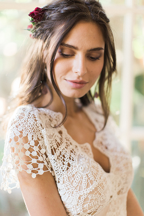 Huntington-bay-club-wedding-close-up-on-bride-bride-behind-groom-bride-in-a-spanish-inspired-style-dress-with-lace-detailing-and-cap-sleeves