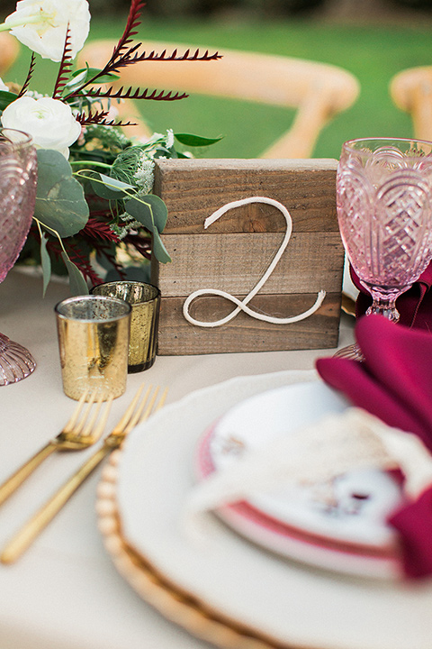 Huntington-bay-club-wedding-table-numbers-on-wooden-blocks-with-metal-numbers