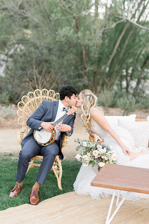 The-Lodge-at-Malibu-Lake-bride-and-groom-with-bbanjo-bride-in-a-full-ball-gown-with-a-deep-v-crystal-detailed-bodice-groom-in-a-slate-blue-suit-with-a-grey-velvet-bow-tie