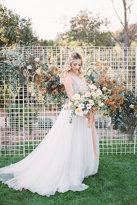The-Lodge-at-Malibu-Lake-bride-in-ceremony-space-alone-bride-in-a-full-ball-gown-with-a-deep-v-crystal-detailed-bodice