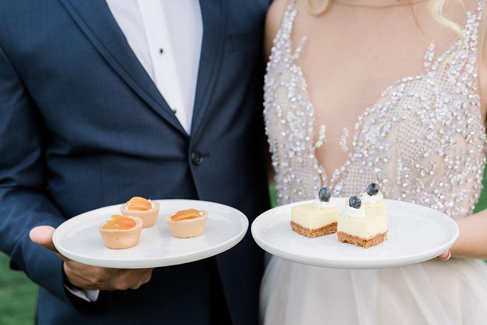 The-Lodge-at-Malibu-Lake-close-up-on-couple-holding-plates