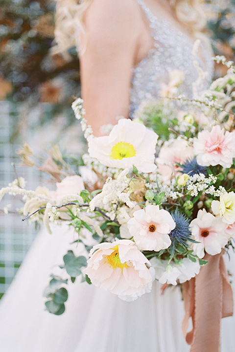 The-Lodge-at-Malibu-Lake-florals-bride-in-a-full-ball-gown-with-a-deep-v-crystal-detailed-bodice-groom-in-a-slate-blue-suit-with-a-grey-velvet-bow-tie