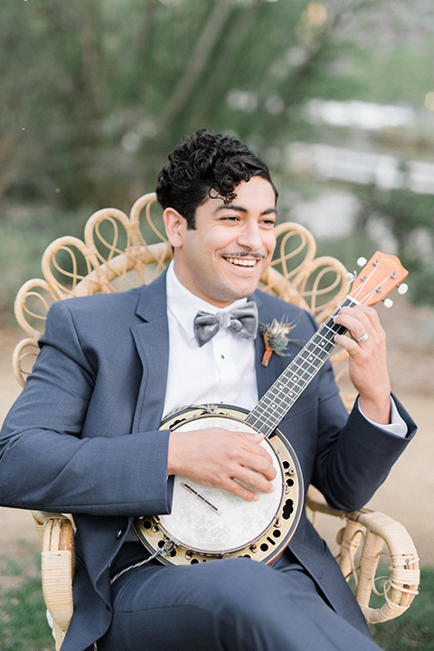 The-Lodge-at-Malibu-Lake-groom-with-banjo-bride-in-a-full-ball-gown-with-a-deep-v-crystal-detailed-bodice-groom-in-a-slate-blue-suit-with-a-grey-velvet-bow-tie