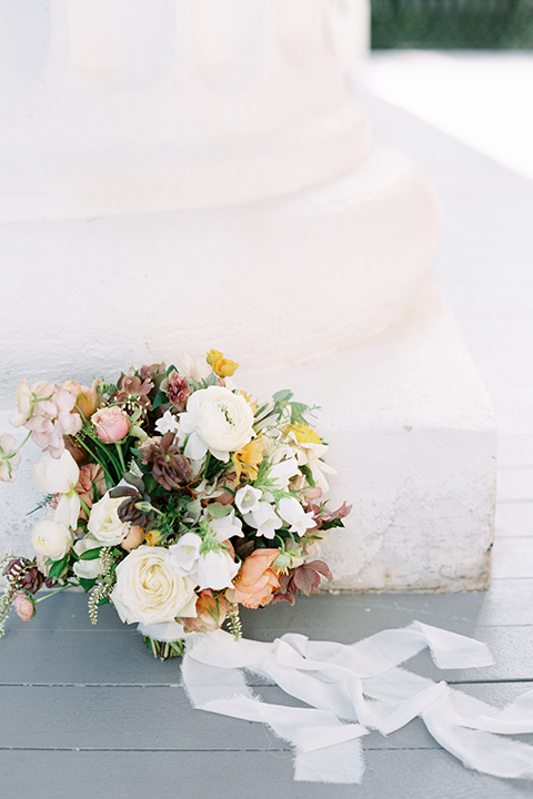 Taylor-Grady-House-shoot-floral-bouquet-simple-mmuted-colors-wrapped-in-a-gorgeous-white-linned-ribbon