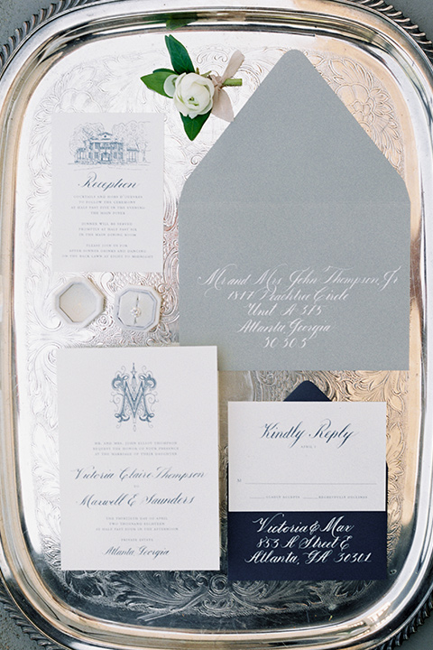 Taylor-Grady-House-shoot-invitations-white-invitations-with-a-dusty-blue-color-to-match-the-accents-of-the-wedding-décor-all-displayed-on-a-mirrored-plate