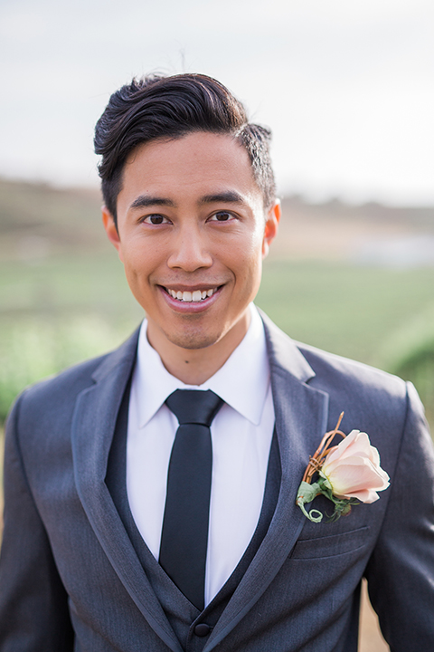 temecula-wedding-avensole-winery-ceremony-groom-charcoal-tuxedo-hands-in-pocket-close-up