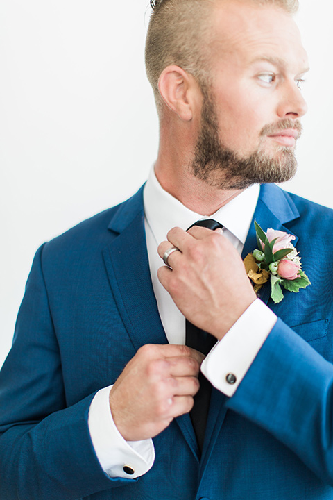 ethereal-shoot-groom-alone-fixing-his-tie-groom-in-a-cobalt-suit-with-a-black-long-tie