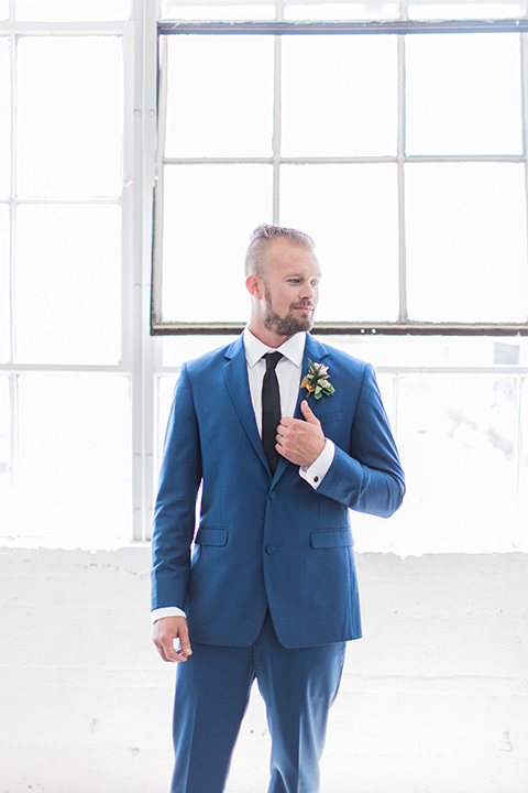 ethereal-shoot-groom-standing-alone-groom-in-a-cobalt-suit-with-a-black-long-tie