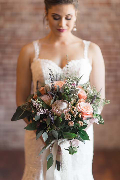 Orange-county-whimsical-wedding-at-franciscan-gardens-bride-holding-bouquet
