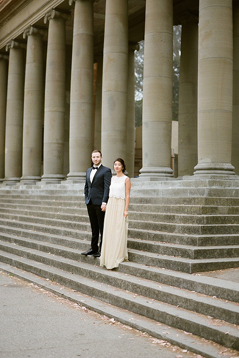 San-francisco-wedding-shoot-at-the-golden-gate-park-bride-and-groom-standing-on-stairs-holding-hands