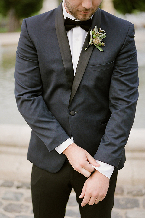 San-francisco-wedding-shoot-at-the-golden-gate-park-groom-navy-tuxedo-fixing-sleeve