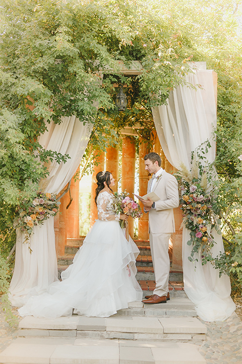 Temecula-outdoor-romantic-wedding-at-humphreys-estate-bride-and-groom-ceremony-standing