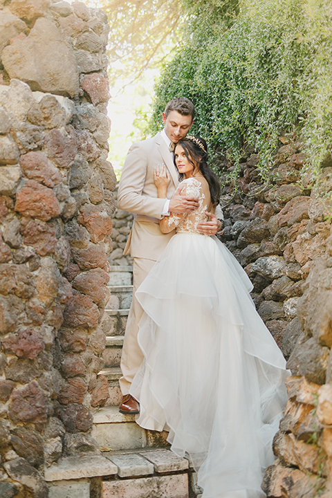 Temecula-outdoor-romantic-wedding-at-humphreys-estate-bride-and-groom-hugging-close-up