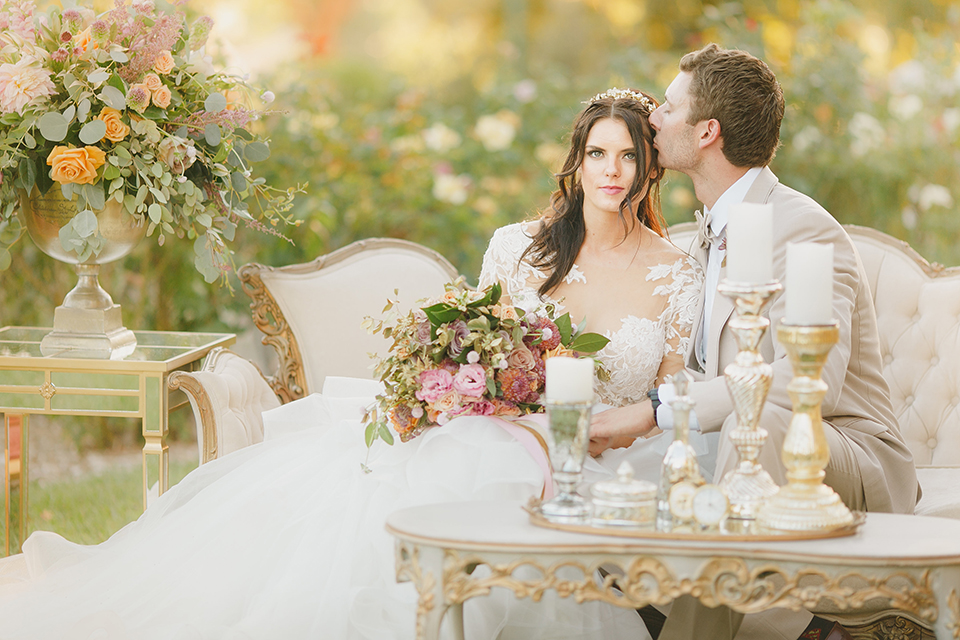 Temecula-outdoor-romantic-wedding-at-humphreys-estate-bride-and-groom-sitting-hugging-and-kissing