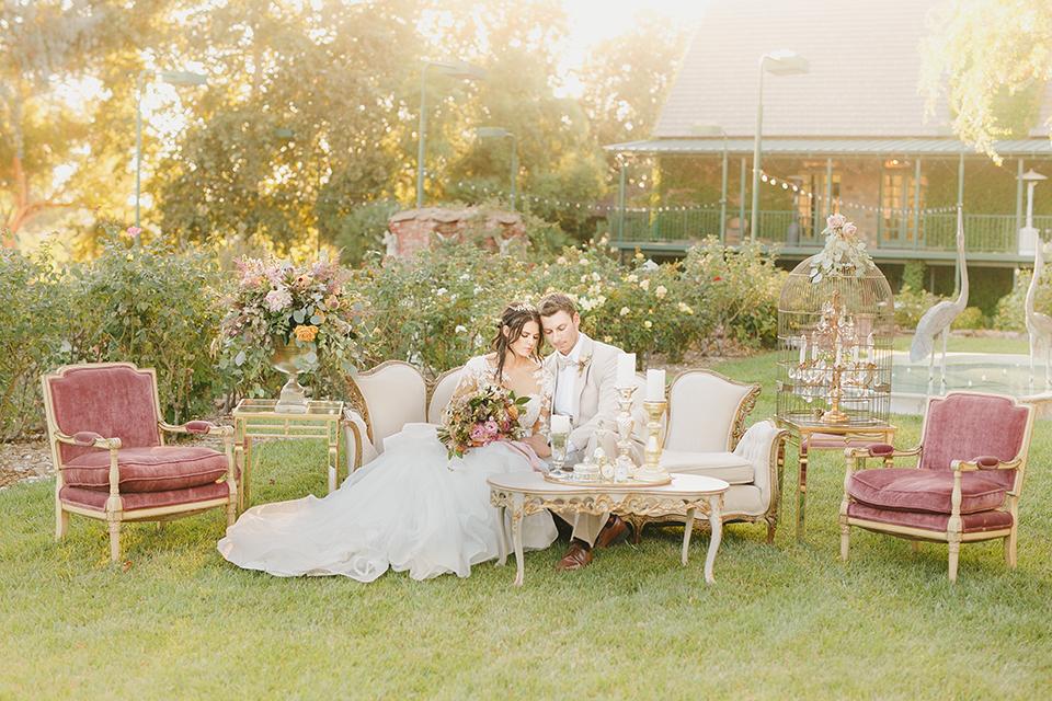 Temecula-outdoor-romantic-wedding-at-humphreys-estate-bride-and-groom-sitting-hugging