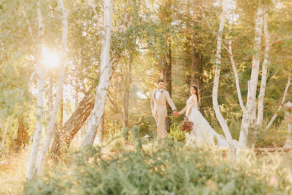 Temecula-outdoor-romantic-wedding-at-humphreys-estate-bride-and-groom-standing-holding-hands