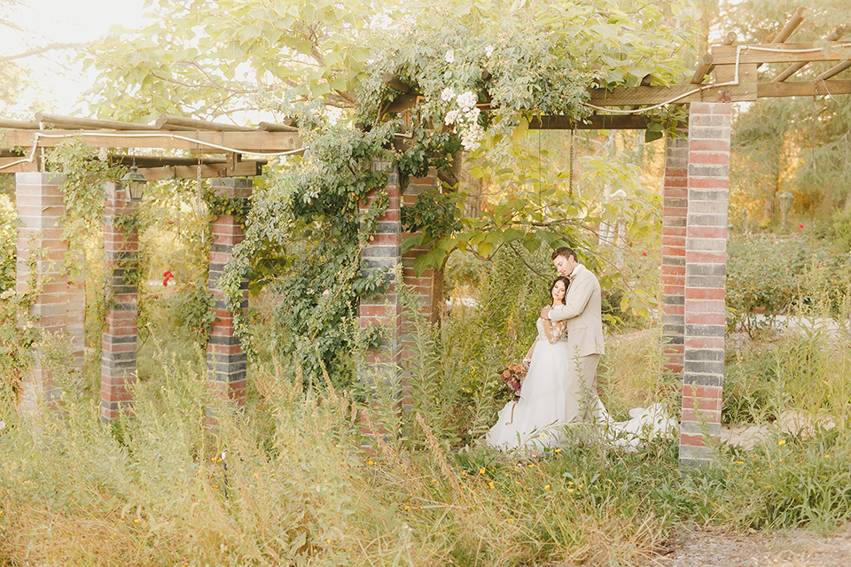 Temecula-outdoor-romantic-wedding-at-humphreys-estate-bride-and-groom-standing-hugging