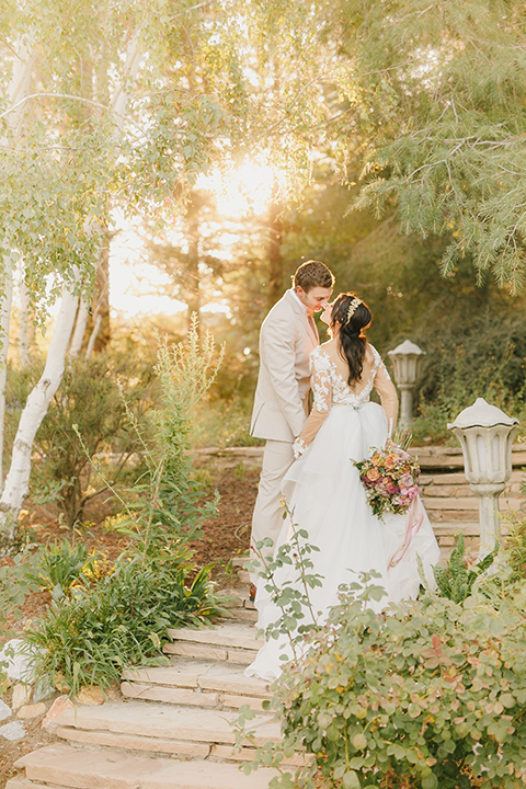 Temecula-outdoor-romantic-wedding-at-humphreys-estate-bride-and-groom-standing-kissing