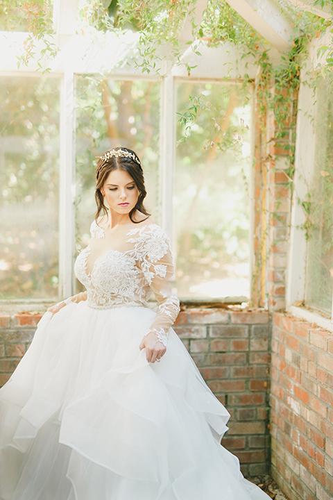 Temecula-outdoor-romantic-wedding-at-humphreys-estate-bride-holding-dress-close-up