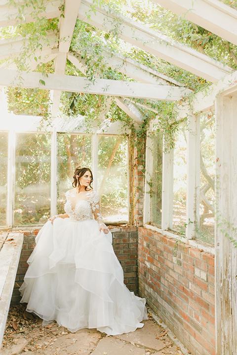 Temecula-outdoor-romantic-wedding-at-humphreys-estate-bride-holding-dress