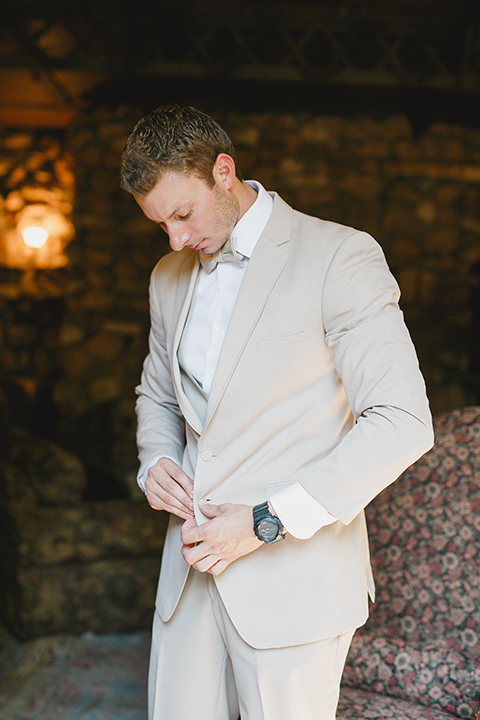 Temecula-outdoor-romantic-wedding-at-humphreys-estate-groom-tan-suit-getting-ready