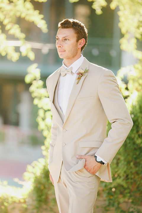 Temecula-outdoor-romantic-wedding-at-humphreys-estate-groom-tan-suit-standing
