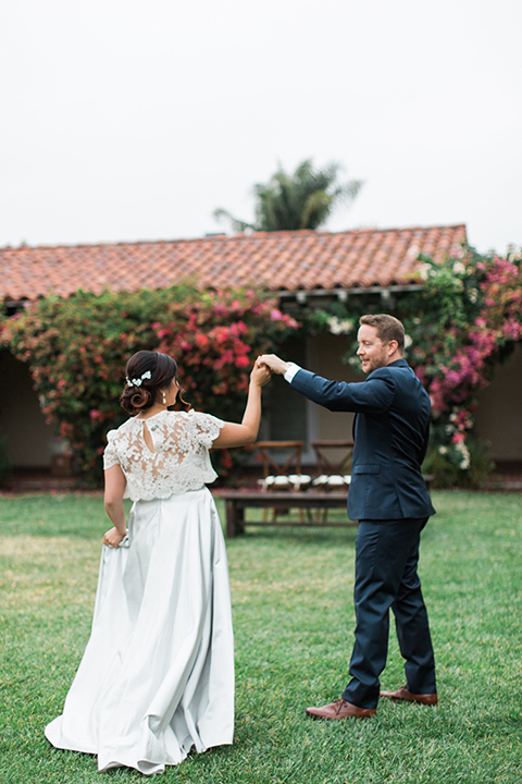 San-diego-outdoor-wedding-at-the-inn-at-rancho-santa-fe-bride-and-groom-holding-hands-and-dancing