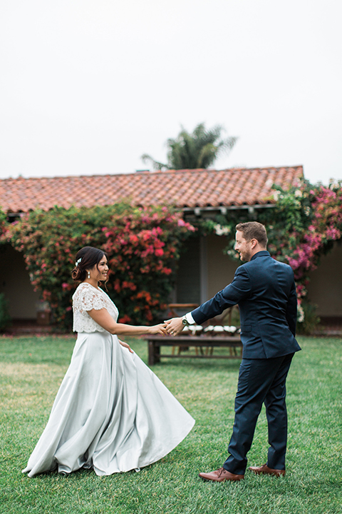 San-diego-outdoor-wedding-at-the-inn-at-rancho-santa-fe-bride-and-groom-holding-hands-smiling