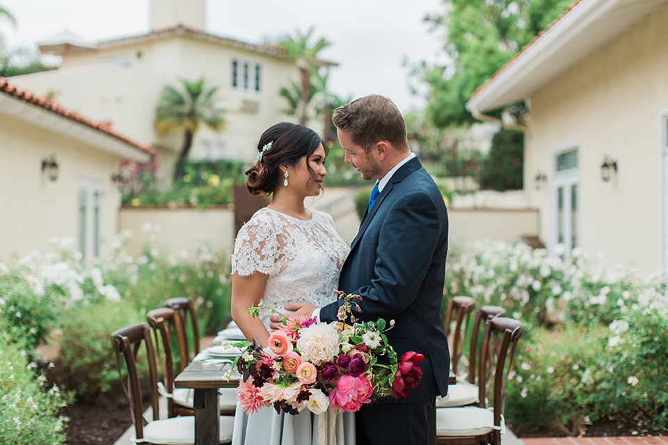 San-diego-outdoor-wedding-at-the-inn-at-rancho-santa-fe-bride-and-groom-standing-by-table
