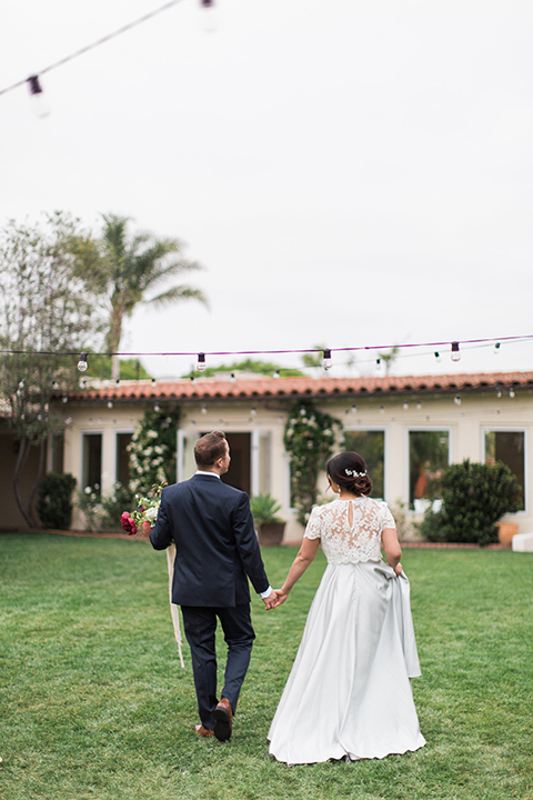 San-diego-outdoor-wedding-at-the-inn-at-rancho-santa-fe-bride-and-groom-walking-holding-hands