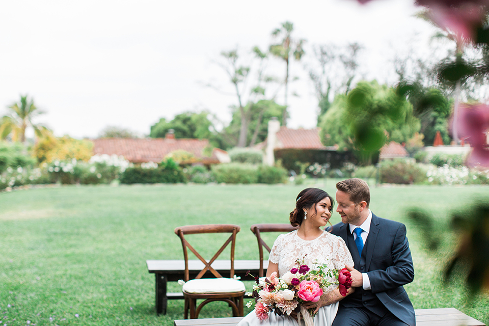 San-diego-outdoor-wedding-at-the-inn-at-rancho-santa-fe-ceremony-bride-and-groom-sitting
