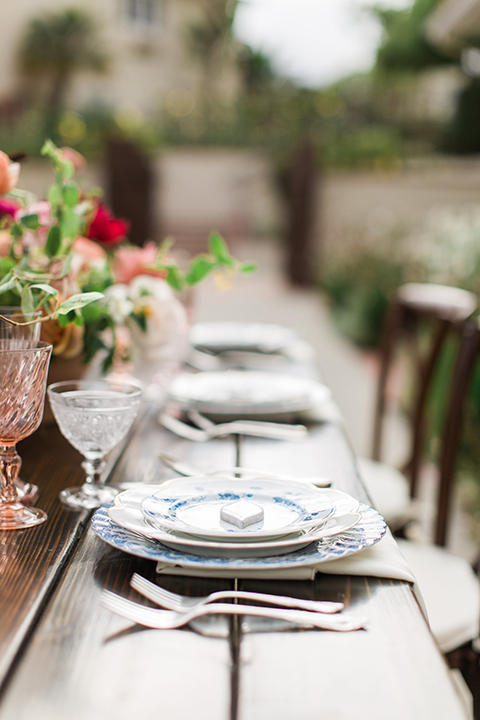 San-diego-outdoor-wedding-at-the-inn-at-rancho-santa-fe-table-set-up-with-flowers-and-place-settings