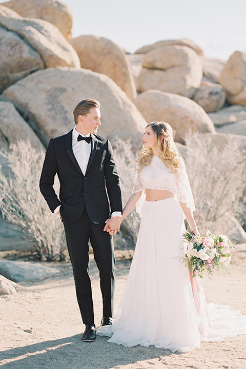 Joshua-tree-wedding-shoot-at-the-ruin-venue-bride-and-groom-holding-hands