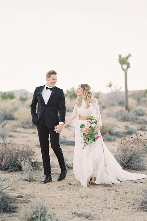 Joshua-tree-wedding-shoot-at-the-ruin-venue-bride-and-groom-standing-holding-hands
