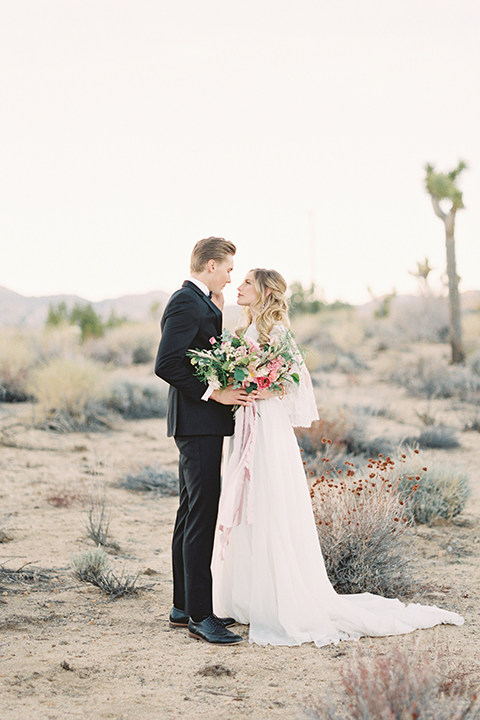 Joshua-tree-wedding-shoot-at-the-ruin-venue-bride-and-groom-standing-hugging