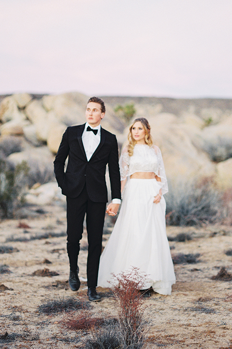 Joshua-tree-wedding-shoot-at-the-ruin-venue-bride-and-groom-walking-holding-hands