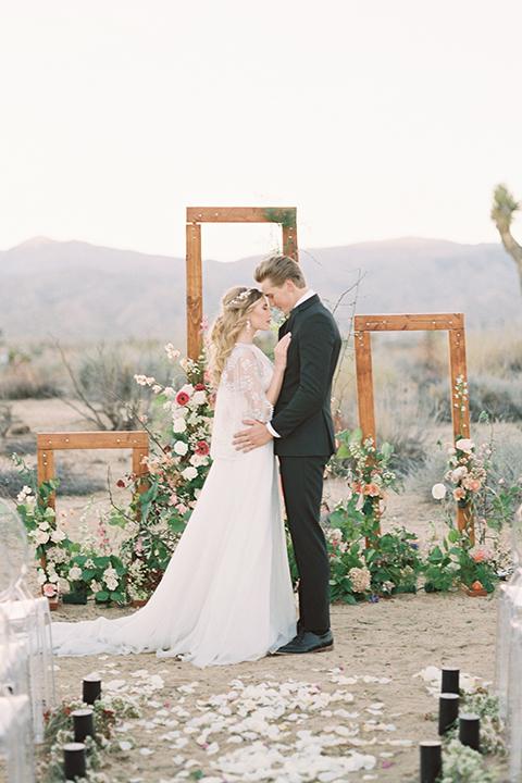 Joshua-tree-wedding-shoot-at-the-ruin-venue-ceremony-bride-and-groom-hugging