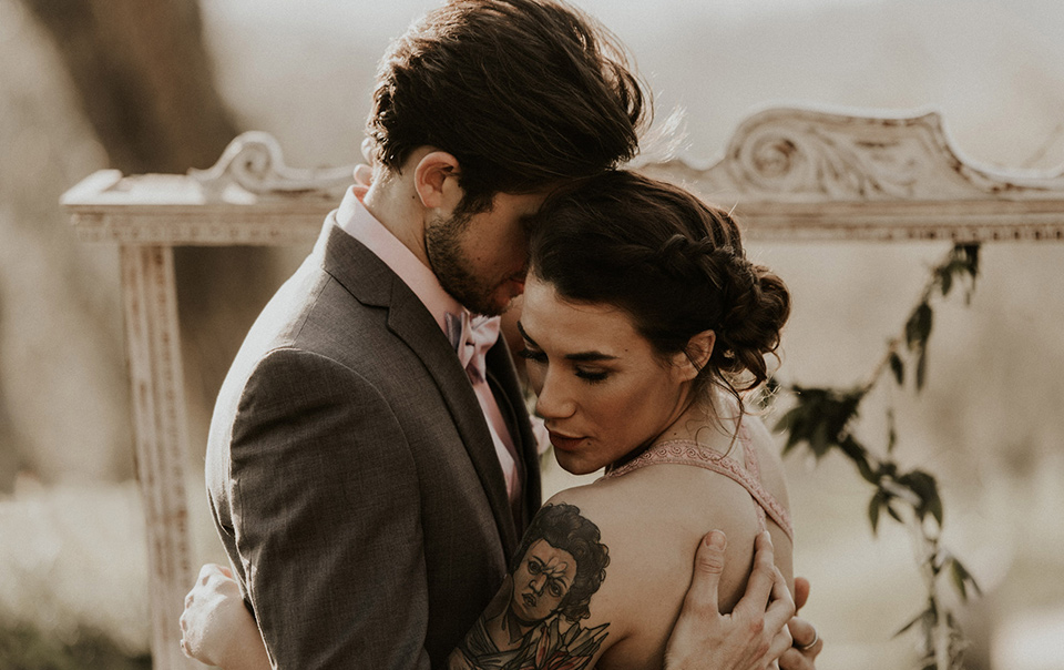 la-dolce-vita-shoot-bride-and-groom-bride-in-a-pink-colored-dress-with-lace-detailing-groom-in-grey-suit-pants-and-vest