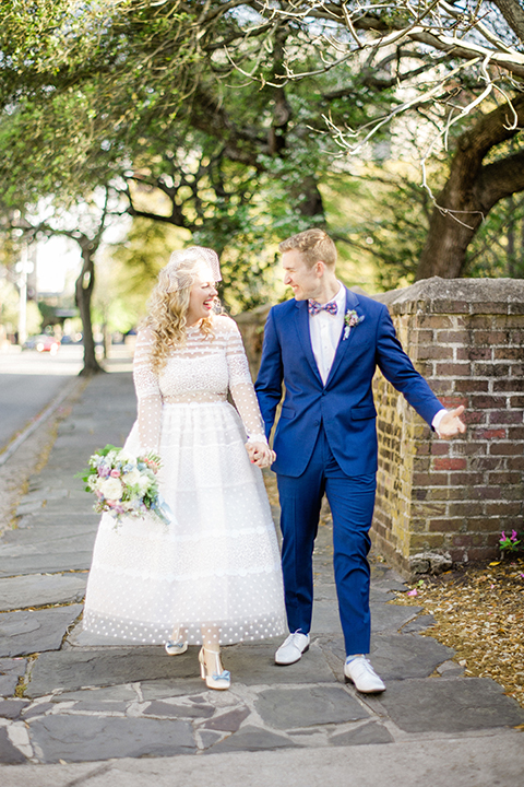 South-carolina-summer-outdoor-wedding-at-the-wickliffe-house-bride-and-groom-holding-hands-and-walking