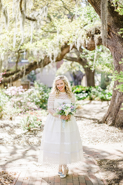 South-carolina-summer-outdoor-wedding-at-the-wickliffe-house-bride-holding-bouquet