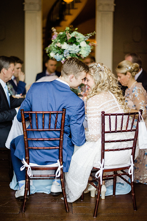South-carolina-summer-outdoor-wedding-at-the-wickliffe-house-reception-bride-and-groom-sitting