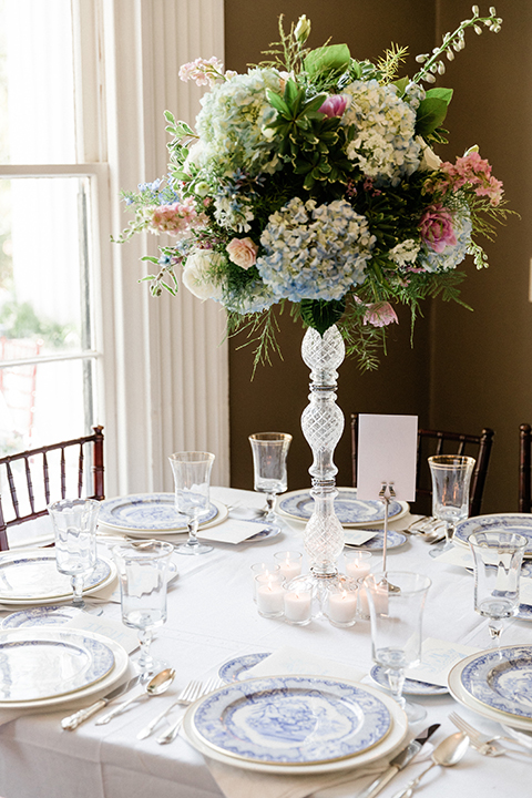 South-carolina-summer-outdoor-wedding-at-the-wickliffe-house-table-set-up-with-flowers