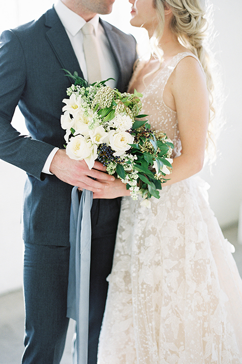 Los-angeles-modern-wedding-at-fd-photo-studio-bride-and-groom-hugging-with-bouquet