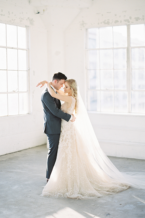 Los-angeles-modern-wedding-at-fd-photo-studio-bride-and-groom-standing-hugging