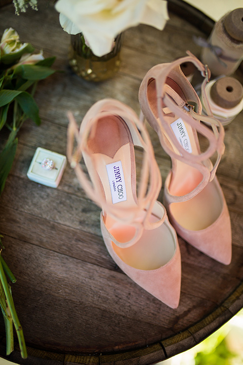 lot-8-bridal-shoes-blush-color-pointed-toe-heels-with-ring-next-to-it-on-wooden-table