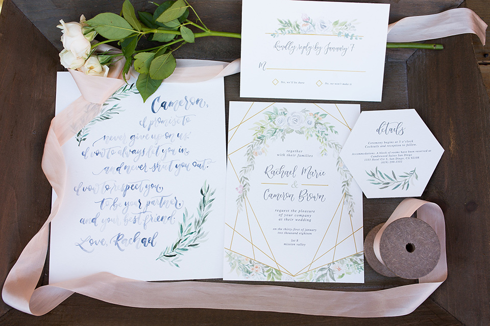lot-8-invitations-with-rose-colored-ribbon-and-white-invitations-that-have-floral-embellishments-andcalligraphy