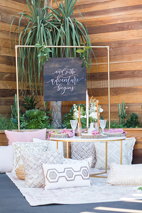 lot-8-set-up-of-recetion-decor-pillows-and-archway-pillows-in-all-rose-white-and-pastel-colors-golden-geometric-arch-withcandles-and-linens-all-around