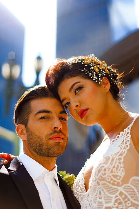 Downtown-los-angeles-wedding-shoot-at-oue-skyspace-bride-and-groom-hugging-close-up